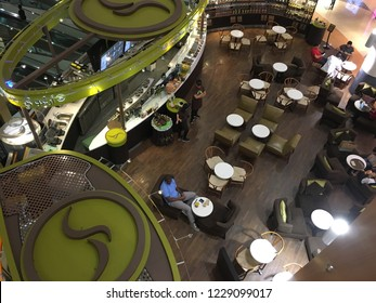 Abu Dhabi,U.A.E.-October 9th,2018: Interiors of cafes at the Al Wahda mall when looking down from a upper floor.