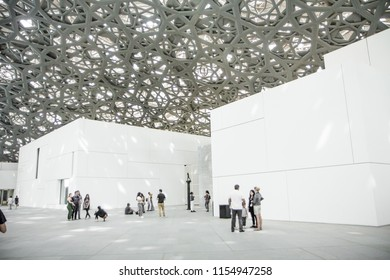Abu Dhabi/United Arab Emirates - July 28 2018 : Louvre Museum Abu Dhabi with visitors walking around
