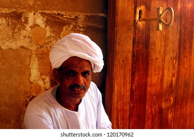 ABU SIMBLE - APRIL 29: Egyptian man at the Great Temple of Abu Simbel on the border of Egypt and Sudan on April 29 2007.The temples were dismantled and relocated in 1968 when Aswan dam was built.