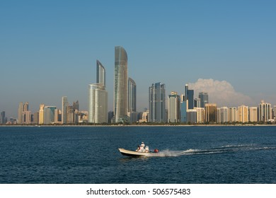 Abudhabi corniche and skyscrapers with sea sports and activities. Abudhabi - United Arab Emirates. October 2016