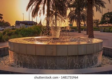 Abudhabi, UAE- July 26, 2019: Water fountain in abudhabi corniche road.