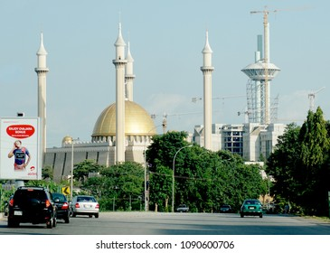 Abuja, FCT/Nigeria - May 13th, 2018: Picture focus on the Abuja National mosque in Abuja, Nigeria. It has 4 minarets and muslims pray 5 times a day. Islam is one of the main religion in Nigeria.