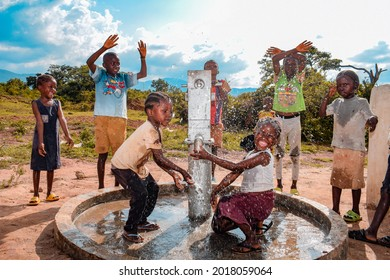 Abuja Nigeria - August 02, 2021: African Children Express Gratitude at Clean Water Pump Dedication Donated to their Community by an NGO. Joyful and Happy Ambience over Water Availability