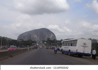 ABUJA,  NIGERIA - CIRCA OCTOBER 2010 : View of ZUMA ROCK and highway near Abuja.