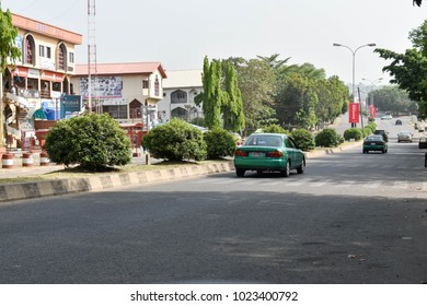 ABUJA, NIGERIA - NOVEMBER 4, 2017: Abuja's green taxi on the tarred road selective focus