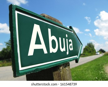 Abuja signpost along a rural road