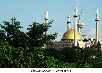 Abuja's National Mosque is the biggest mosque in Nigeria and West Africa. Built in 1984 in the capital city, Abuja, Nigeria. The mosque is where Muslims pray 5 times a day. It has also 4 minarets.