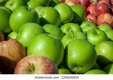 An abundance of fresh and crispy red and green apples displayed for sale at a local Turkish village market; cropped to fill the frame