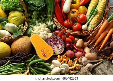 Abundance of organic vegetables culinary herbs and mushrooms in a basket / vegetable still life
