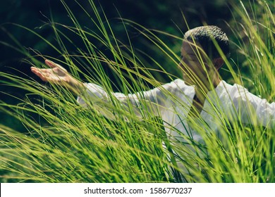 Abundance in Springtime, Woman with Open Arms, Connected with Nature, Enjoying Life