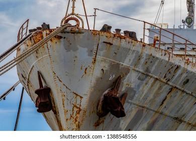 Abundant  navy vassal  at port.