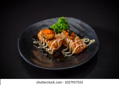 Aburi Salmon Foie Gras Nigiri, Salmon and Foie Gras Sushi Nigiri served on traditional Japanese food on ceramic dish, Japanese food style on black background, japanese dishes, selective focus