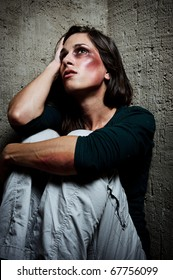 Abused woman wondering why her loved one would hurt her in this way