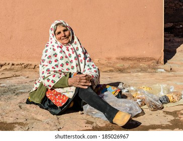 ABYANE, IRAN - JAN 9, 2014: Unidentified local woman in traditional clothes in Abyane, Iran. Abyane is a traditional village, very popular for the tourist