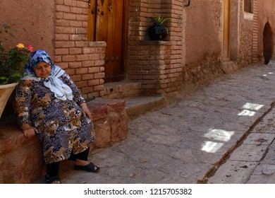 ABYANEH, IRAN - AUGUST 31: Old lady in the village at 31 August, 2018 at Abyaneh, Iran. Abyaneh has a small, medieval community in Central Iran.