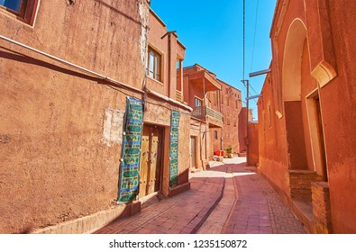 ABYANEH, IRAN - OCTOBER 23, 2017: Walk the narrow curved street of the ancient red-ochre village of Abyaneh - the famous tourist object, located adjacent to Kashan, on October 23 in Abyaneh.