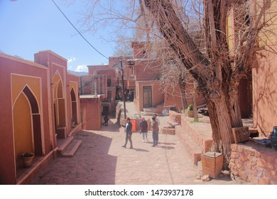 Abyaneh Village, Iran - 22 April 2019 : The street with tree and reddish hue buildings in Abyaneh Village which is the oldest Iranian traditional village in Isfahan, Iran.