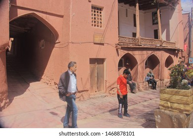 Abyaneh Village, Iran - April 22 2019.  The street scene near reddish hue Purzala Mosque or Purzaleh Mosque in Abyaneh Village, a traditional Iranian village in Isfahan Province, Iran.