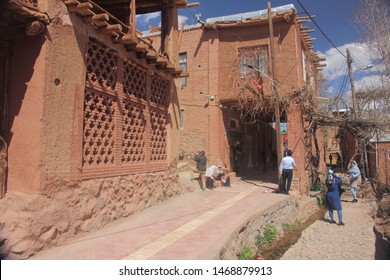 Abyaneh Village, Iran - April 22 2109. A street along the red hue buildings in Abyaneh Village, whic is the oldest traditional Iranian village in Isfahan Province, Iran.