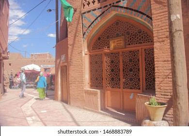 Abyaneh Village, Iran - April 22 2019.  The street of Abyaneh Village, an oldest Iranian traditional village wit the arched door of Jame Mosque.