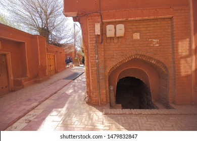 Abyaneh Village, Iran - April 22, 2019 :  The quiet road between the red-colored buildings in the traditional Iranian village of Abyaneh which has being well known for its red-brick houses.