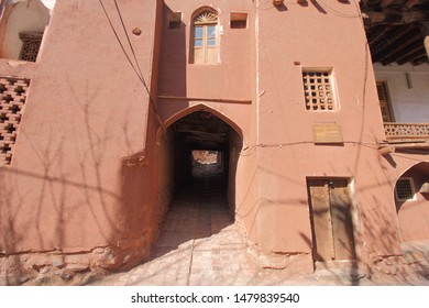 Abyaneh Village, Iran - April 22, 2019 : Part of the Puzaleh Mosque with underpass alley in the traditional Iranian village of Abyaneh which has being characterized by red stones buildings,