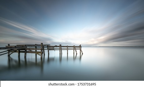 The Abyss, jetty in the Markermeer the Netherlands during the sunset.