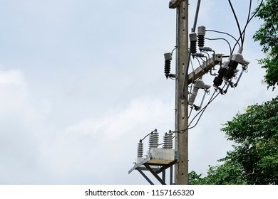 AC high-voltage power transformer. Electrical energy transfer to end users through distribution transformer on concrete pole changing high voltage to low voltage in Thailand