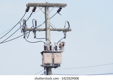 AC high-voltage power transformer. Electrical energy transfer to end users through distribution transformer on concrete pole changing high voltage to low voltage.