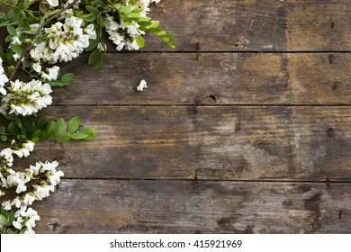 Acacia flower on the old wooden background