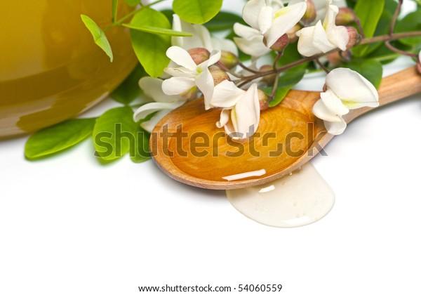 acacia honey in a wooden spoon