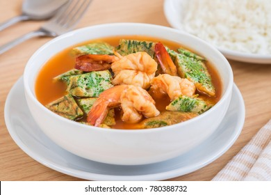 Acacia leave omelet and shrimp in spicy sour soup and rice on plate, Thai food
