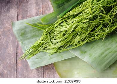 acacia pennata / cha-om in the threshing basket on wooden table