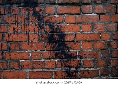 acade of a brick wall. Red brick masonry. Black paint wall