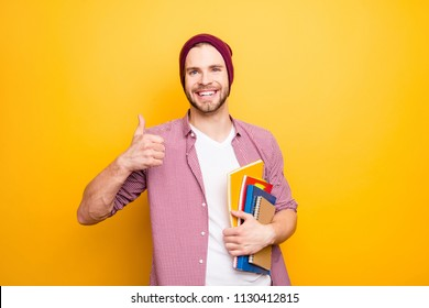 Academic high school swag stylish modern nerd exam people good mood person concept. Portrait of excited handsome rejoicing delightful boy with toothy smile showing finger up symbol isolated background