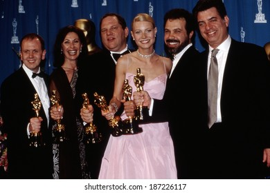 Academy Award winners for SHAKESPEARE IN LOVE David Parfitt, Donna Gigliotti, Harvey Weinstein, Gwyneth Paltrow in gown by Ralph Lauren, Edward Zeick and Marc Norman, March, 1999