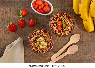 Acai berry cups on wooden background