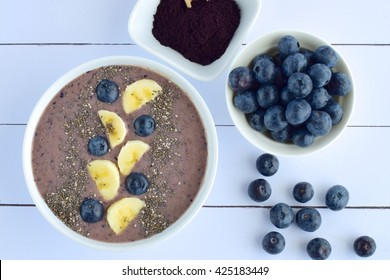Acai berry smoothie bowl with banana, blueberry and chia seeds