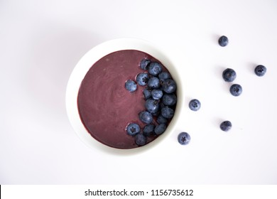Acai bowl with blueberry on the white table