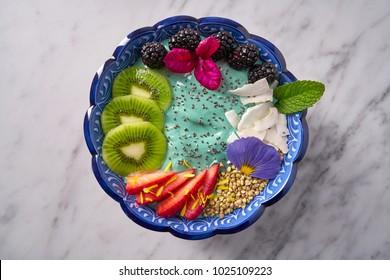 Acai bowl smoothie with kiwi blackberry strawberry and chia seeds