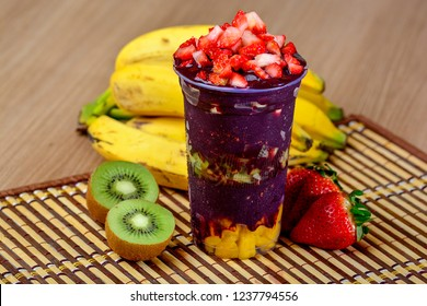 Acai Cup With Strawberry Topping Banana And Kiwi, Delicious Brazilian Açaí