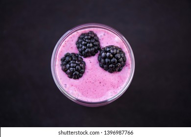Acai Smoothie with fresh blackberries in the glass cup