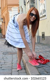 Acallosity.  The beautiful woman changes the shoes.
