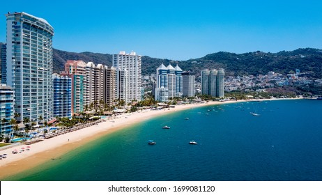 Acapulco, Guerrero / Mexico - April 7 2020: The beach in Acapulco is closed and are empty during spring break because of the Coronavirus outbreak.