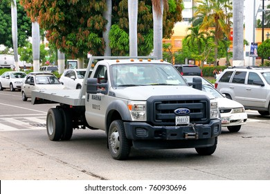 Acapulco, Mexico - May 30, 2017: Tow truck Ford F-550 in the city street.