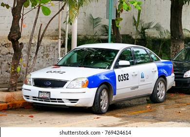 Acapulco, Mexico - May 30, 2017: Taxi car Ford Five Hundred in the city street.