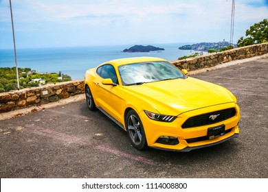 Acapulco, Mexico - May 31, 2017: Yellow muscle car Ford Mustang in the city street.