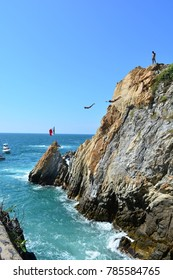 ACAPULCO, MEXICO - NOV 11TH, 2017: Unidentified clavadista - profesional jumper - jumping at the beautiful beach of La Quebrada, in Acapulco, Mexico, on Nov 11th, 2017