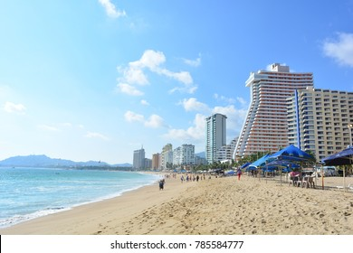 ACAPULCO, MEXICO - NOV 11TH, 2017: Unidentified tourists at the beautiful beach of Acapulco, Mexico, on Nov 11th, 2017