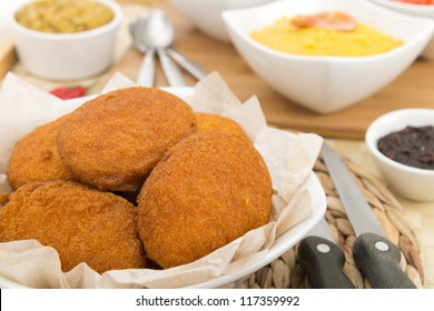 Acaraje - Traditional Brazilian fritters made with black-eyed peas served with vatapa, caruru, and chilli sauce. Typical food from Bahia.